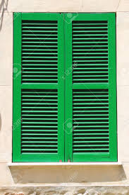 italian style shutters in a old palace stock photo picture and