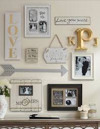 wood frame wall decor my gallery wall of wedding photos my home and it s decor