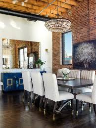 Mirror Over Buffet by Loft Dining Room Features A Robert Abbey Bling Chandelier
