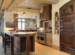 a farmhouse style kitchen with wood cabinets an onyx counter