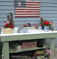 organized clutter a red white and blue potting bench