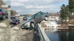 wrecked car teen survives after wrecked car ends up teetering on bridge above