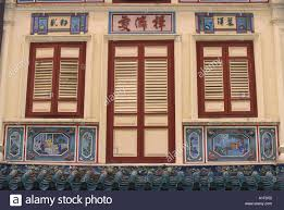 close up of closed shutters on doors and windows and decorative