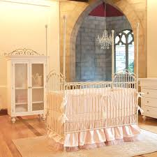 venetian iron crib in distressed white and nursery necessities in
