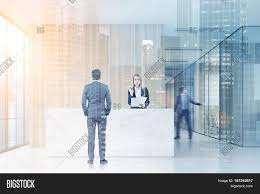 Double Reception Desk by Man Standing Near A Reception Desk Talking To A Receptionist His