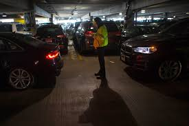 logan airport tries new ways to handle overflow parking all central parking garage attendant nicole finnerty registers a parking customer into the system with a phone