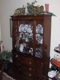 how to arrange a corner china cabinet it s time to get rid of your china cabinet nourishing