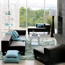 black patterned cushions black leather couch with blue blanket and cushions combined by blue