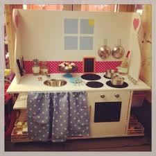 upcycled play kitchen from our old tv table so pleased with it