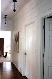 planked wall hallway gets new light fixtures forever cottage
