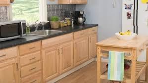 how to refinish wood veneer kitchen cabinets how to reface kitchen cabinets with self stick veneer