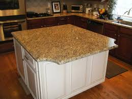 white kitchen cabinets with gold countertops new venetian gold granite with white cabinets traditional