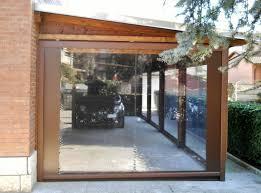 struttura in legno per tettoia tettoia in legno lamellare addossata con tende a chiusura
