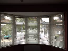 perfect wooden blinds for bay windows contoured venetian in polar
