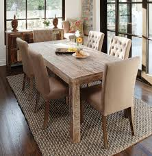 pleasant dining room with big wooden cabinet facing reclaimed wood
