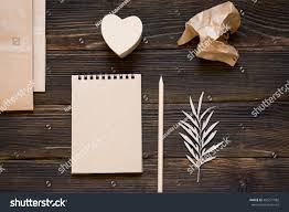 heart shaped writing paper royalty free writing love letter for valentine s day 485271982 writing love letter for valentine s day brown style notebook pencil heart shaped box envelope crumpled piece of paper on dark wooden background