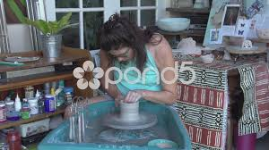 video woman throwing a pot on a potter u0027s wheel 51200129