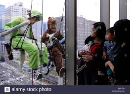 tokyo japan 18th dec 2013 window cleaners clad in costumes of