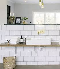 White Bathroom Light Fixtures by Bronze Bathroom Light Fixtures Brown Laminated Flooring Square