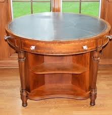 henredon round library table with tool and gilt leather top ebth