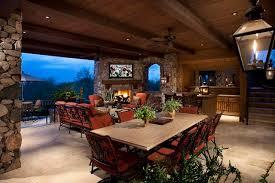 outdoor living room design gray stone floor table glass vase