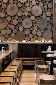 revetement mural bois the wall of logs in this beerhall is meant resemble a forest floor