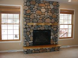 home design stone fireplace glass table stone wall wooden closet