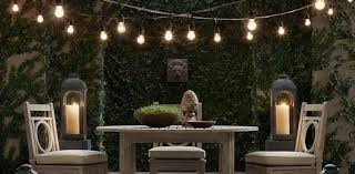 simple outdoor dining room with black canopy bulb patio light