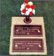 granite bronze bronze veterans marker and matching memorial on a single grave