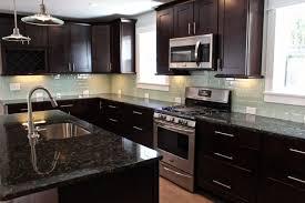 travertine tile backsplash kitchen granite countertop pendan light