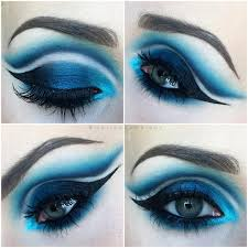 halloween makeup eyes bright blue eye makeup with negative space cut crease liner