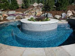 pool design round shaped pool and spa design with plantation in