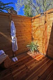 outdoor shower enclosure ideas showers are our specialty bathroom open shower area with brick accent wall and wooden floor completed plant ideas for inspiring outdoor