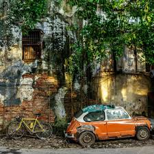 rusty car photography rusty car and bicycle near abandoned building u2013 stock editorial