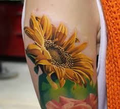 colorful 3d sunflower tattoo on right half sleeve by ryan evans