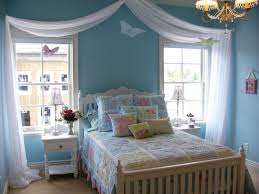 nicely blue tween girls bedroom with white curtain and brown floor
