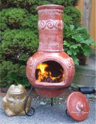 furniture orange clay chiminea outdoor fireplace with black iron