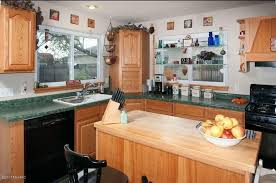 white kitchen cabinets with green countertops what to do with a kitchen with wood cabinets and green