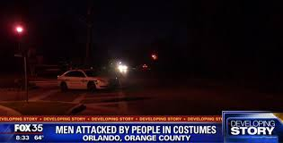 people wearing halloween costumes stab man attack another with