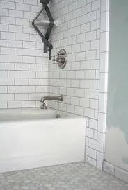 mid century bathroom reno straight herringbone subway tile