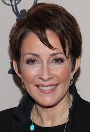 layered short hairstyles for women over 50 patricia heaton layered short cut with bangs hairstyles weekly