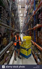 cyber monday or black friday amazon stock pickers in the amazon fulfillment centre warehouse in