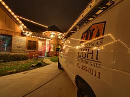 putting up christmas lights business about us the christmas light professionals