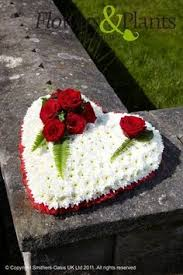Funeral Flower Designs - beautiful red roses in a heart shape floral arrangements