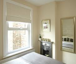 bedroom patterned bedroom roman blinds with small fireplace