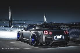 nissan gtr liberty walk blue the liberty walk gtr r35 looks monstrous in this photoshoot
