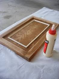 Adding Trim To Kitchen Cabinets by How To Make Ugly Stock Cabinets That Are Just Flat On Top And