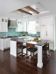 white kitchen cabinets with wood beams white kitchen with island and reclaimed wood beams