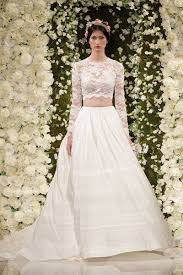 the new ways brides are showing skin crop top and slits in