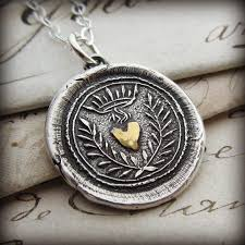 wax seal jewelry flaming gold heart wax seal necklace shannon westmeyer jewelry